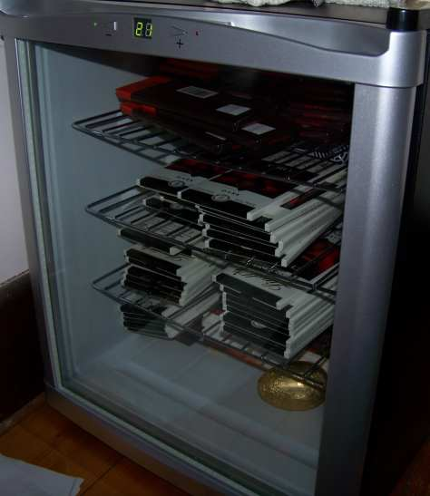 A small fridge full of chocolate