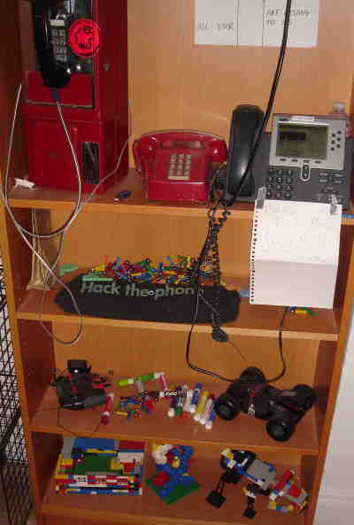 VOIP phone in use, pay-phone for decoration, and Magnetix