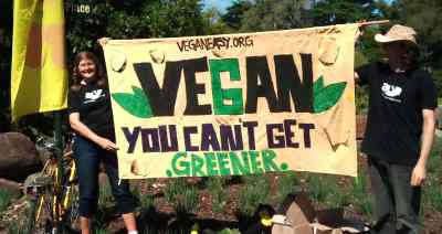 Vegans waving a banner for VeganEasy.org
