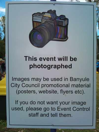 sign saying This event will be photographed. Images may be used in Banyule City Council promotional material (posters, website, flyers etc).  If you do not want your image used, please go to Event Control staff and tell them.