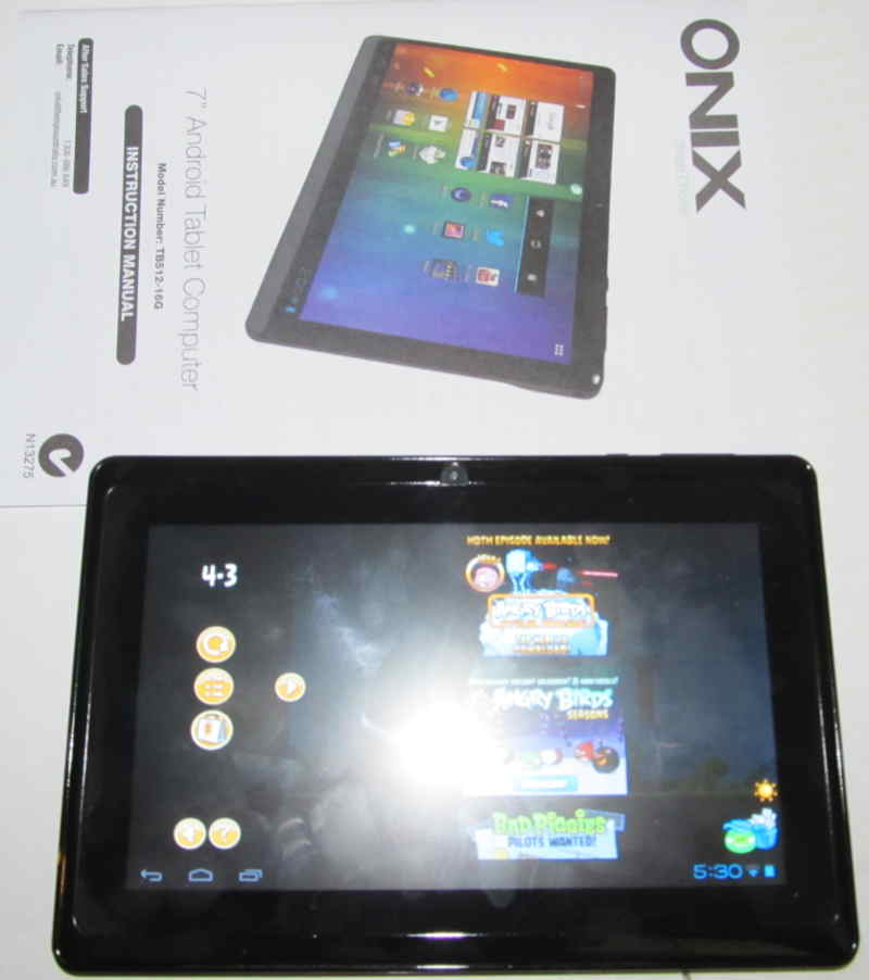 front of the onix 7 inch tablet and cover of manual