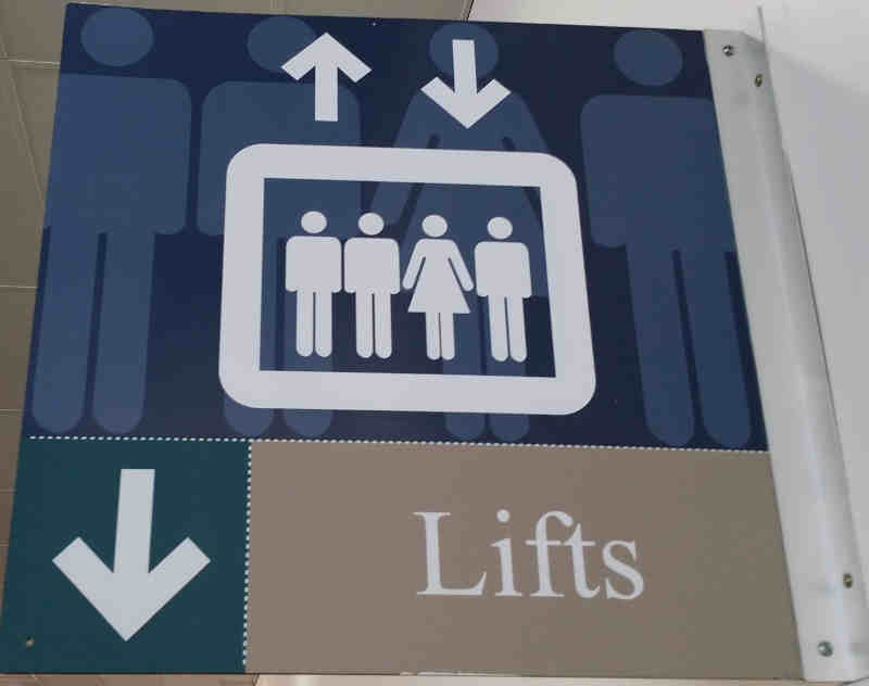 3 men 1 women on lift sign