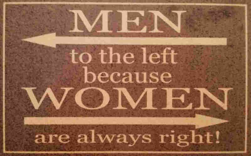 sign saying men to the left because women are always right